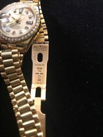 Ladies 18kt Gold Rolex with Diamond Bezel