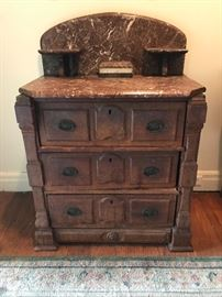 Small marble top dresser