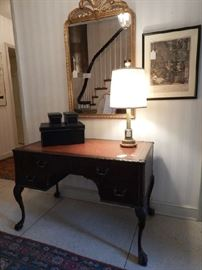 GILT MIRROR AND LEATHER TOP WRITING TABLE