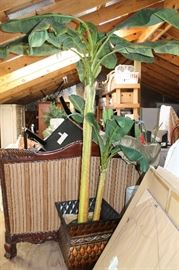 Artificial tropical banana tree in a large container