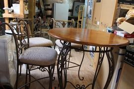 Tall iron table with 3 bar stools