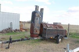 Bar-B-Q pit with smoker on wheels
