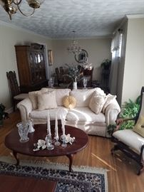 White Couch and cherry table. Room full of cherry furniture, antiques  and more.