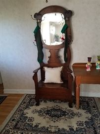 This Antique Hall tree is in great shape. We kept our family photos in it for years.. This is one piece I hate to sell, but it won't fit in my house.