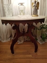 Cherry marble top table with oil lamp that has been electrified.