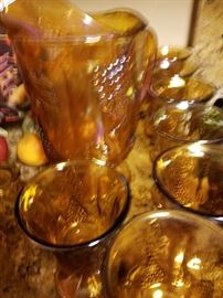 Beautiful Complete Set of Amber Carnival glasses with matching pitcher. Eight goblets.