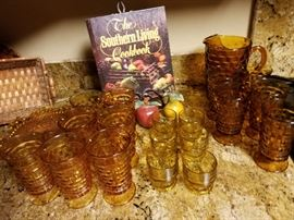Great set of Mid-Century Amber glasses. There are two complete sets of tumblers, six juice glasses and a matching pitcher.