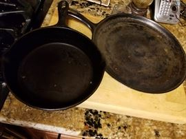 Several cast iron skillets.