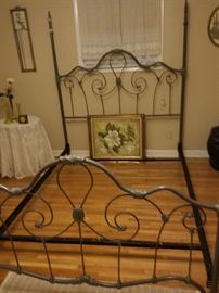 Iron bed with a green cast. Oil painting of a magnolia.