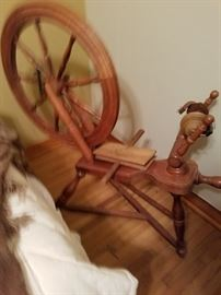 Mom's spinning wheel and wool combs.
