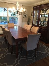Dining room table. Includes 6 chairs pictures and leaf