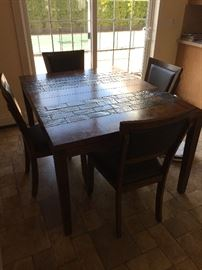 Dining room table. Includes 6 chairs pictures and leaf not pictured.