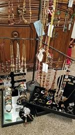 We have a table full of jewelry. Anything from Jade, coral, freshwater pearls, Sterling Silver, African, Peru, Indonesia, and even some custom made items here from the USA