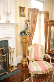 """Brass fireplace screen and tools; gilt column pedestal; Angelo Basso bronze, """"Riding the Wave;"""" pair of pink strip chairs"""