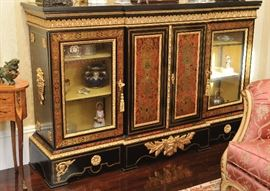 """Louis Philippe - style marble-top ebonized breakfront with inlay and ormolu details; silk linked. Measurements: 5' 7"""" x 3' x 1' 1"""""""
