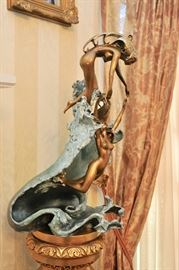"""Detail of Angelo Basso Bronze, """"Riding the Wave."""""""