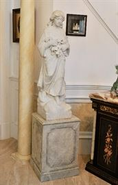 Marble figural statue on marble plinth