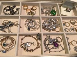 Great assortment of sterling silver and gold jewelry.