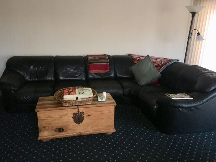 Black leather sectional sofa & Pottery Barn chest