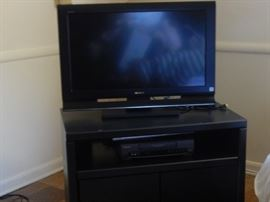 Flat screen tv and shelf.