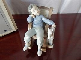 "Lladro ""All Tuckered Out""  https://www.ctbids.com/#!/description/share/2564"