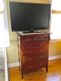 Antique chest and flatscreen tv