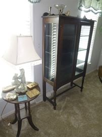ANTIQUE  DISPLAY CABINET ON LEGS. GLASS ON THE SIDES WILL SHOW OFF YOUR COLLECTIBLES NICELY