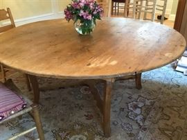 Antique pine table 71 inches in diameter