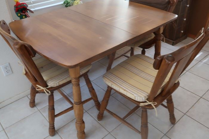 Early American style table and 5 chairs.