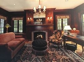Gorgeous library filled with designer furniture and Oriental wool rug