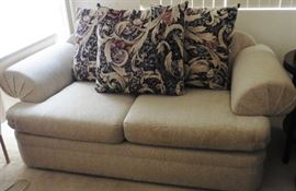 Loveseat with reversible cushions.