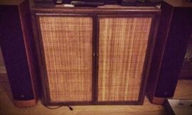 tv  and stero cabinet, with woven front and leather accents. JM Labs speakers