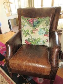 Leather club chair with vintage bark cloth pillow