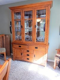"Fairmont Designs, Mission Oak Dining Suite. Offers 8 chairs in total 2 with arms, one extra table extension, table pads and a matching china cabinet. Table, as shown, is 6 feet by 42inches.  China Cabinet is 56"",x 18 deep by 6' tall."