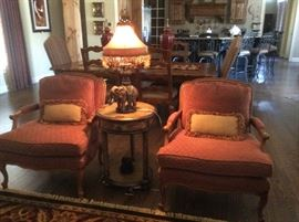 Matching burnt orange chairs with pillows
