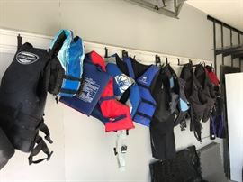 Ocean pacific and various other brands of life vests and body suits. Adult and kids.
