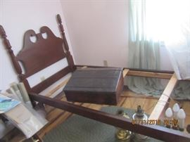 Carved posts twin bed. The pine schoolmasters desk is also pictured.
