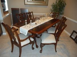 the Chippendale dining set with two leaves, beautiful condition. Ask about delivery service!!!!