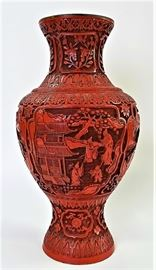 Antique hand carved Red Chinese Cinnabar Vase | Decorated with detailed floral designs | In excellent condition. No chips or cracks. Measures almost 13 inches in height.