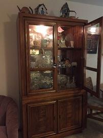 Nice oak lighted china cabinet  $125.00.