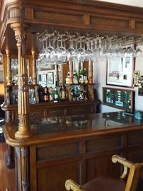 Fine Furniture Bar. Hardwoods/Cherry Solids and Veneers;Rattan;Leather. The top unit with posts provides canister lighting and overhead stemware storage, supported by heavily carved posts.
