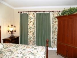 Drapes and Curtain Rod.  Beautiful lamps.