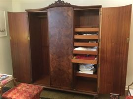 Armoire open - middle door opens too - has shelves or can use either way