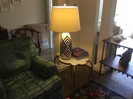Mid-Century end table and lamp table is unusual shape with brass colored legs