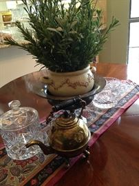 Biscuit barrel; brass tea pot; artificial arrangement