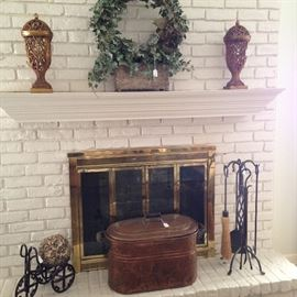 Mantel decor; great copper vat; black fireplace tools