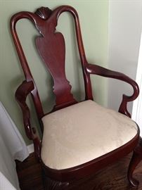 One of the two arm chairs