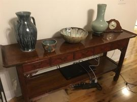 Oriental console with pottery
