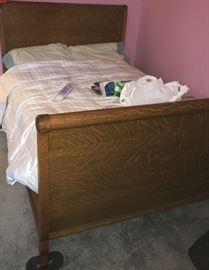 Full size antique oak bed...high headboard. Circa 1910