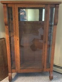 1915 oak empire style china cabinet. Locked...needs a key. Shelves are there.